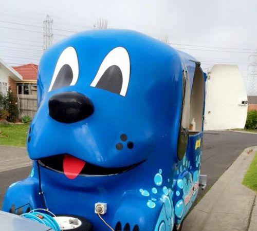 Blue Wheelers mobile grooming salon, blue dog, big blue dog, blue dog trailer, dog grooming salon, blue wheeler salon,