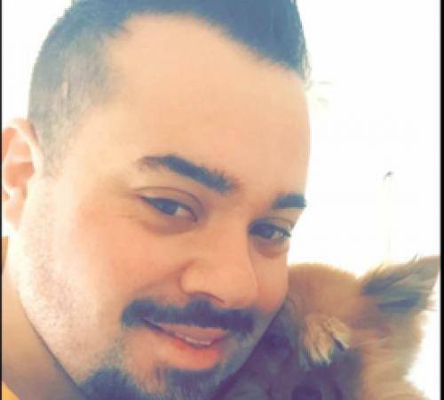 mobile dog groomer cuddling a dog, cute dog, man holding dog, cute dog, groomer holding dog,male groomer, male dog groomer, dog groomer, cute dogs