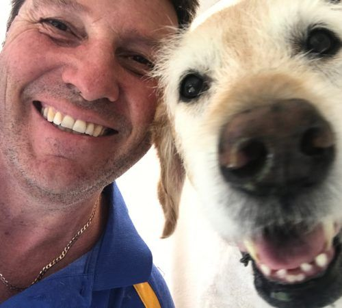 man holding dog, cute dog, groomer holding dog, male groomer, male dog groomer, dog groomer, cute dogs, mobile dog wash trailer, Labrador, labs, cute Labradors, cute labs, yellow labs, yellow Labrador