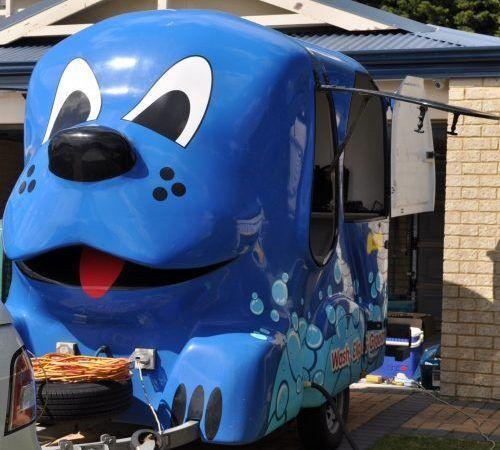 Blue Wheelers mobile grooming salon, blue dog, big blue dog, blue dog trailer, dog grooming salon, blue wheeler salon,