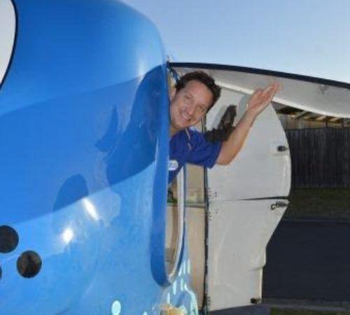 Blue Wheelers mobile grooming salon, blue dog, big blue dog, blue dog trailer, dog grooming salon, blue wheeler salon,male groomer, male dog groomer, dog groomer