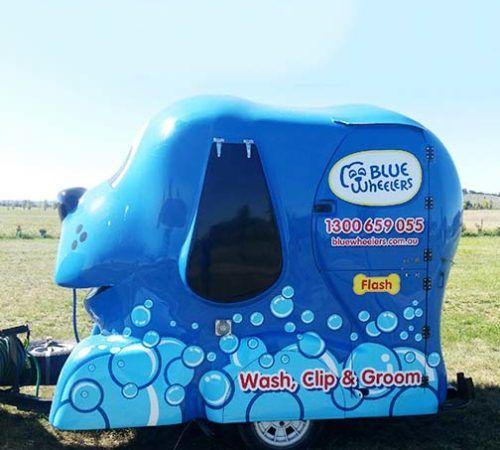 Blue dog, Blue Wheelers, Blue Wheelers Mobile Grooming, Blue Wheelers mobile grooming trailer, grooming trailer, mobile grooming trailer, big blue dog, dog wash trailer, dog grooming trailer, mobile dog wash trailer, mobile dog grooming trailer, blue wheelers mobile dog grooming trailer, blue wheelers mobile dog wash trailer.
